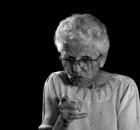 Old Woman With Glasses Wagging Her Finger in Anger Stock Photo - 1216054