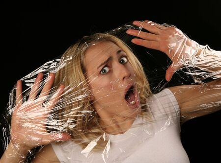 tied hair: Donna intrappolata e sentimento soppresso  Archivio Fotografico