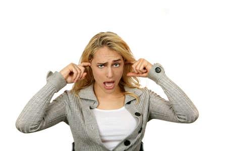 berisping: Vrouw inpluggen Haar oren niet horen wat er gebeurt Stockfoto