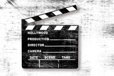 hollywood film: Grunge Old Used Movie Clapper Board on White