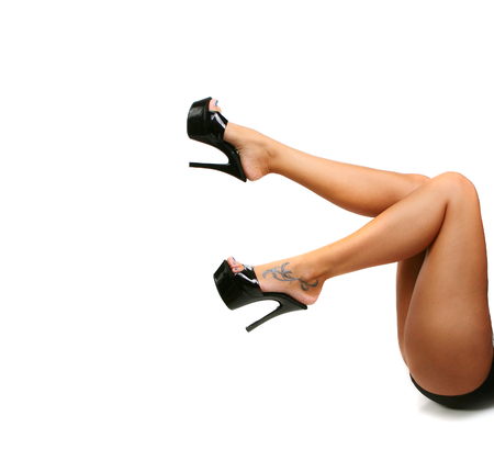 fem: Tanned Sexy Legs With Black Pumps on White