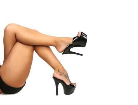 fem: Sleek Sexy Legs With Black Pumps on White Stock Photo