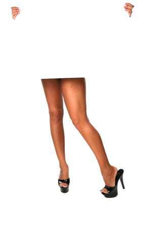 Sexy Legs With Black Pumps Holding Sign on White photo