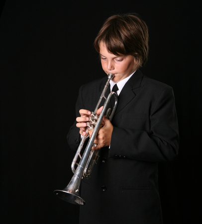 rehearse: Young Teenager Playing the Trumpet on Black