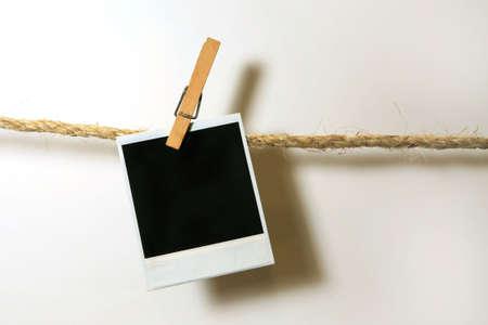 paper pin: Clothespins Holding One Vintage film Grunge Frame