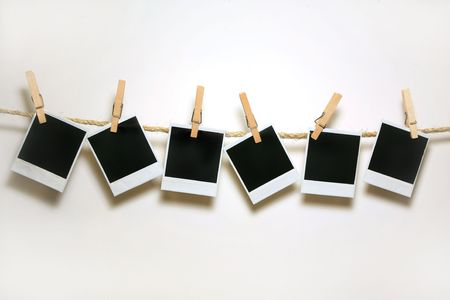 old photo: Crooked Old Film Blanks Hanging on a Rope Held By Clothespins