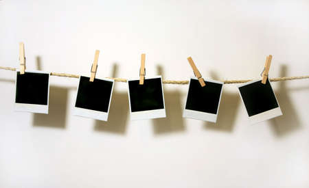 blanks: Old Film Blanks Hanging on a Rope Held By Clothespins