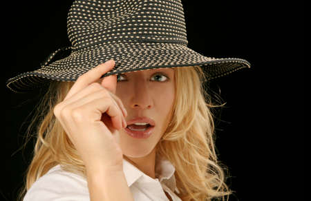 Portrait of a Beautiful Young Womans Face Close-up in Glamour Pose With Fashion Hat