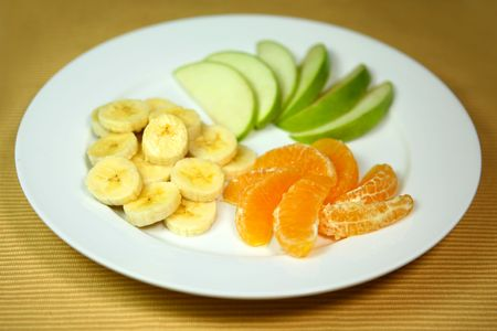Apples Bananas and Oranges on a Plate Ready to Eat