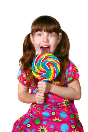female tongue: Adorable Child Licking a Large Lollipop on White Background Stock Photo