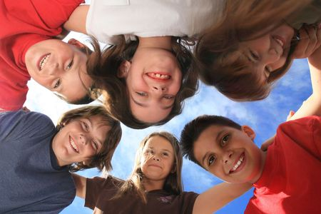 huddle: Group pf Very Happy Children Laughing Aloud Stock Photo