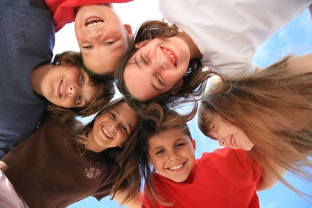 grouping: Six Kids Laughing Outdoors in the Sunshine Stock Photo