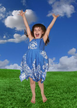 express positivity: Child Jumping and Happy Outdoors on a Beautiful Day