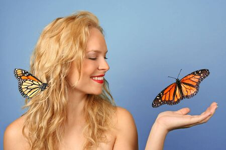 Beautiful Woman With Butterfly in Her Hand and Hair photo