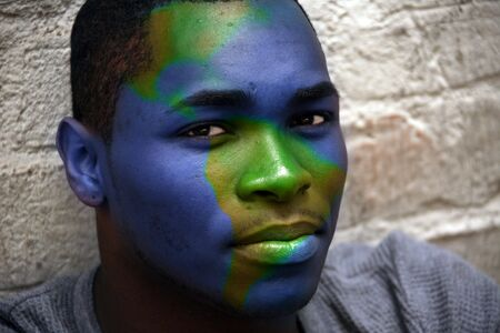 African American Male Portrait With Globe Painted on His Face photo