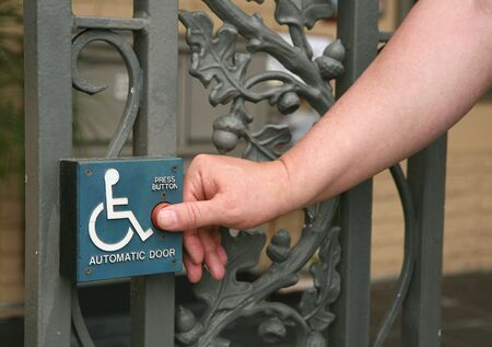 pushed: Handicap Access Automatic Door Button Being Pushed by a Gentleman