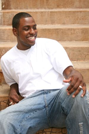 Happy Laughing African American Male on Stairway photo