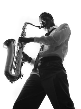 African American Male Playing a Saxophone With Emotion Stock Photo