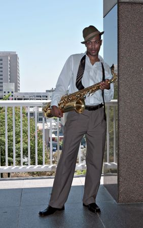african sax: Handsome Black Saxophone Player in Casual Business Attire Stock Photo