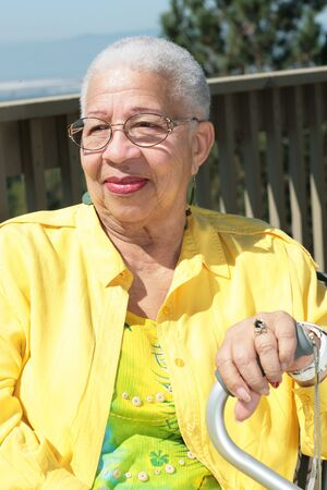 onward: African American Elderly Woman Watching Onward Stock Photo