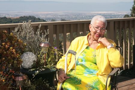 Happy African American Old Woman Smiling While Resting Outdoors