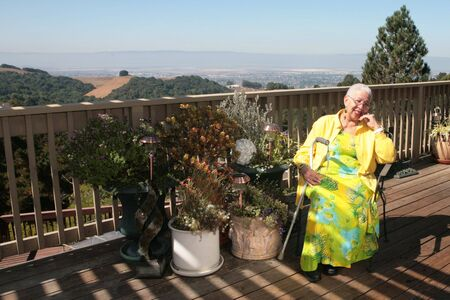 Retired Woman Resting Outdoors on a Wooden Deck