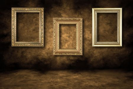 picture frame on wall: Three Guilded Picture Frames Hanging on a Grungy Wall Stock Photo