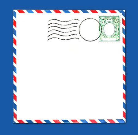 airmail: Old Airmail Parcel Type Envelope With Postal Stamp and Stripes Distressed and Grungy Stock Photo