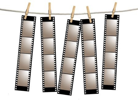 Blank 35mm Film Strip Negatives Hanging From A Rope By Clothespins Stock Photo