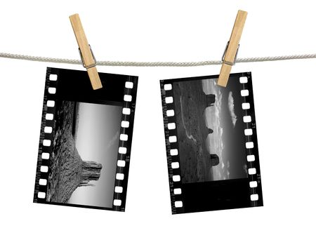 gigantic: Black and White 35mm film negatives of Monument Valley Hanging on A Clothesline With Clothespins Stock Photo