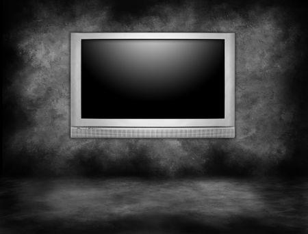 definici�n: Televisi�n de plasma de plata colgando de una pared interior en un cuarto oscuro