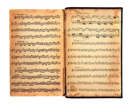 music: Worn Tattered Distressed Vintage Book With Music Printed on the Pages Stock Photo