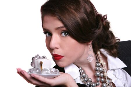 High Fashion Retro Style Woman Holding a Teacup Full of Jewelry Stock Photo - 3574889