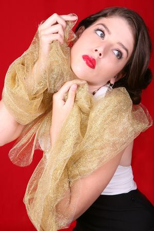 Dramatic Beautiful Woman Holding Gold Fabric Against Her Face Stock Photo - 3596729