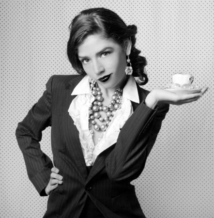 Sexy Woman Dressed in Retro Vintage Style Holding a Teacup in Black and White Stock Photo - 3596663