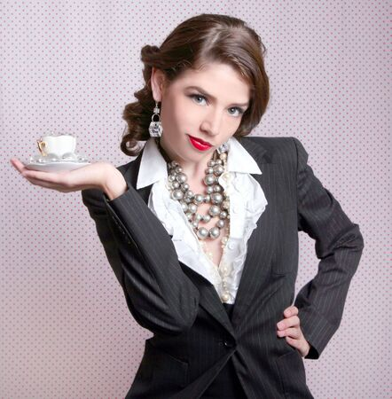 Sexy Woman Dressed in Retro Vintage Style Holding a Teacup photo