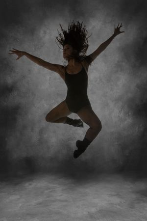 Young Street Dancer Leaping Mid Air With Dramatic Lighting Intentional Motion Blur