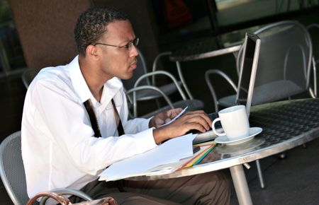African American Black Businessman Working on His Laptop Outdoors photo