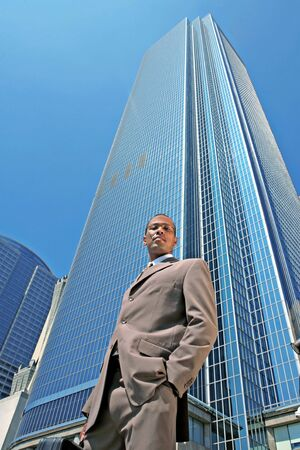sky scrapers: Handsome Black Business Man Outdoors Next to Office Buildings