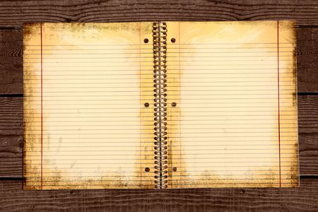 Distressed Lined School Paper in a Binder on Grunge Background photo