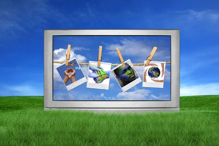 Large Screen Television Isolated Outdoors With Global Issue Concepts Hanging on Film Blanks photo
