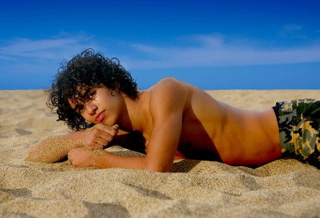 Ethnic Handsome Teenage Youth on the Beach Stock Photo - 3938759