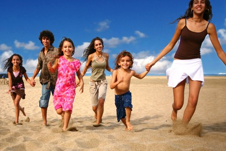 diversity children: Funny Happy Children Running on the Beach Stock Photo