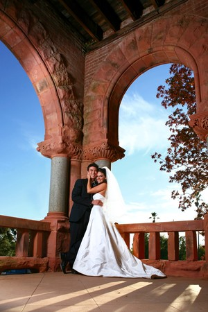 Beautiful Couple Outdoors on Their Wedding Day photo