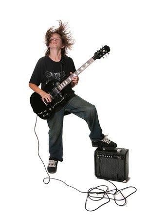 cool boy: Young Teen Adolescent Playing Black Electric Guitar on White Background With Amplifier Stock Photo