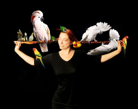 Woman Who Has Multiple Exotic Birds in Her Very Long Red Hair photo