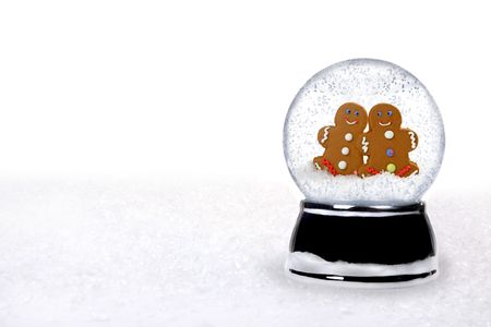 2 Happy Gingerbread People Inside a Snowglobe in Love on Christmas Holiday photo