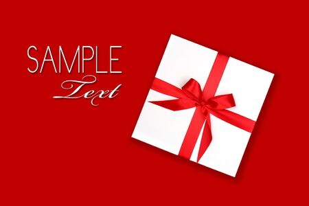 Wrapped Holiday Gift With Red Ribbon and Bow on Red Background For Your Design Stock Photo - 3987710