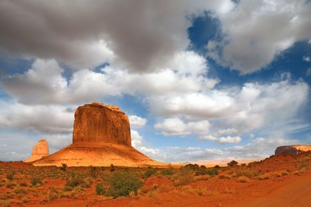 Monument Valley Giants With Cloud Cast Shade Dancing Along the Valley Stock Photo - 3987758
