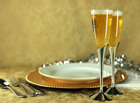 Pair of Champagne Flutes Next to Dinner Place Setting With Copy Space Stock Photo - 4090486